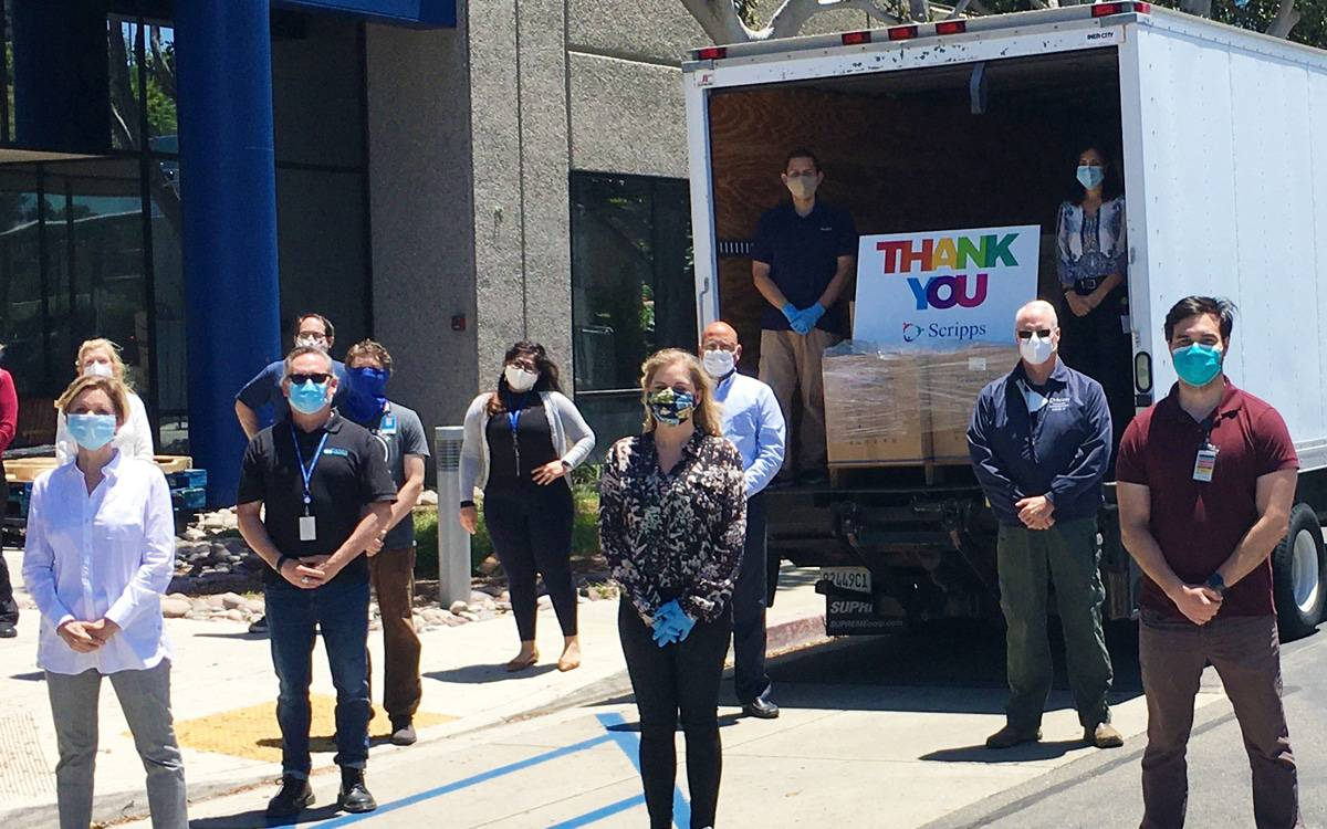Scripps hospital workers receive truck full of donations and Thank You sign.