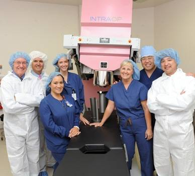 Oncologists gather for a photo near the INTRAOP machine.