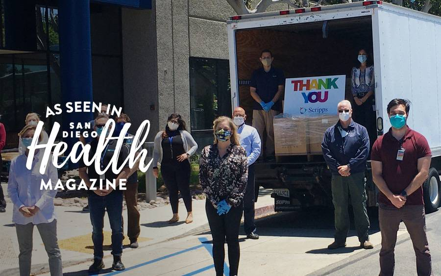 Members of the Scripps Health administration stand near a truck to unload COVID supplies donated by the San Diego community.