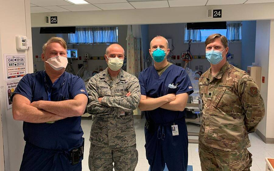 Matthew Martin (third from the left), MD, a Scripps trauma surgeon stands with a COVID-19 medical team in a Bronx hospital.